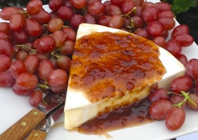 buffet cheese platter with fig and grape