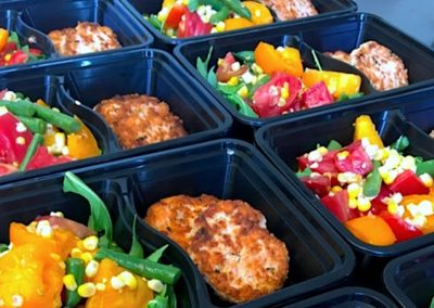 prepared meal salmon cakes with summer tomato salad